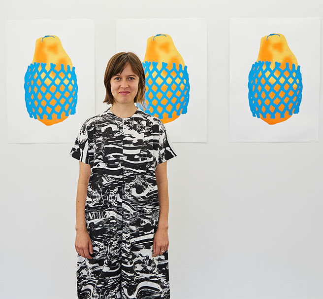 Alice Oehr, artist, infront of her work titled Papayas