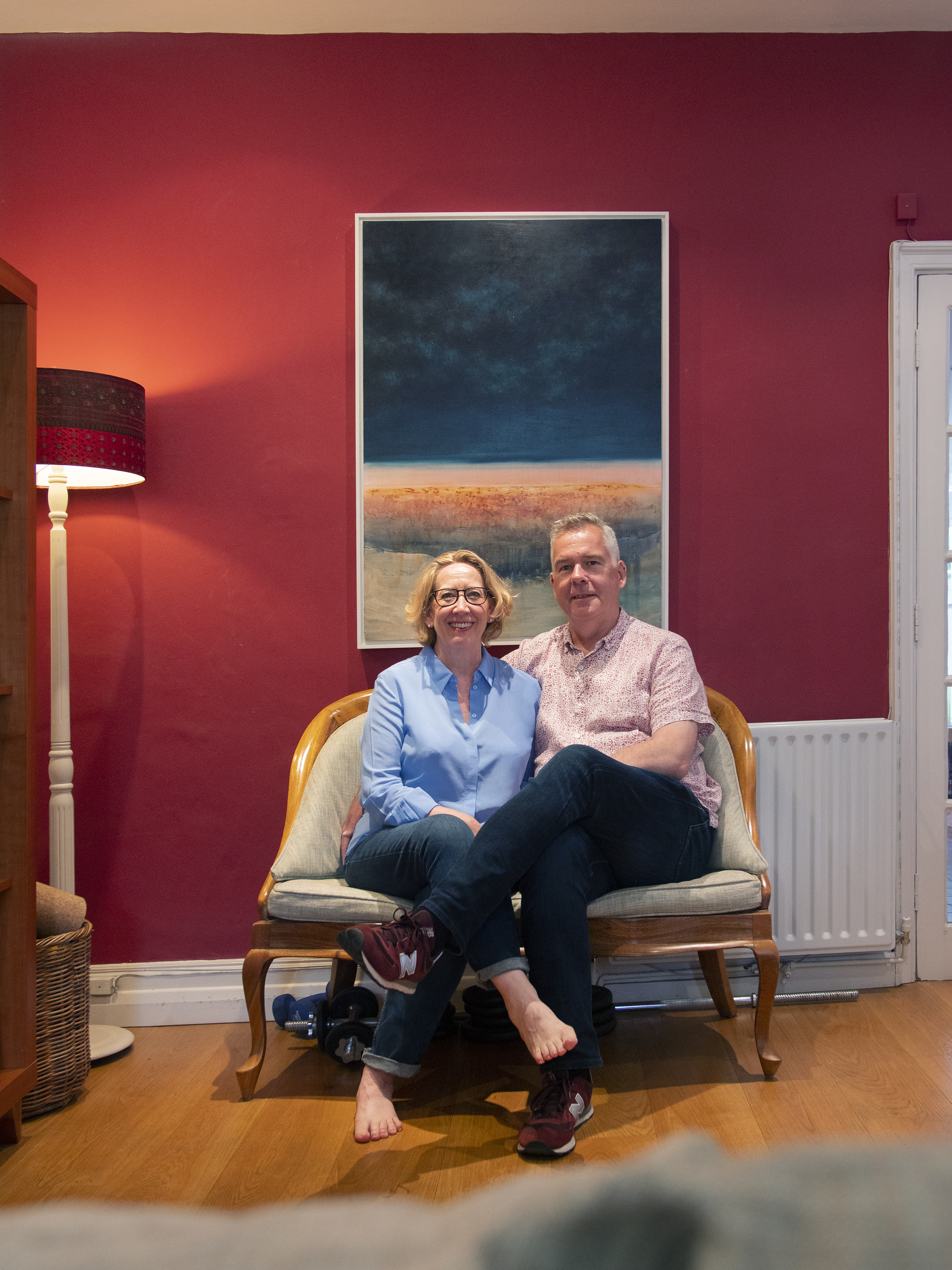 Joanna and her husband infront of their Daniel Ablitt painting, Will's Art Warehouse. Purchased Spring, 2018