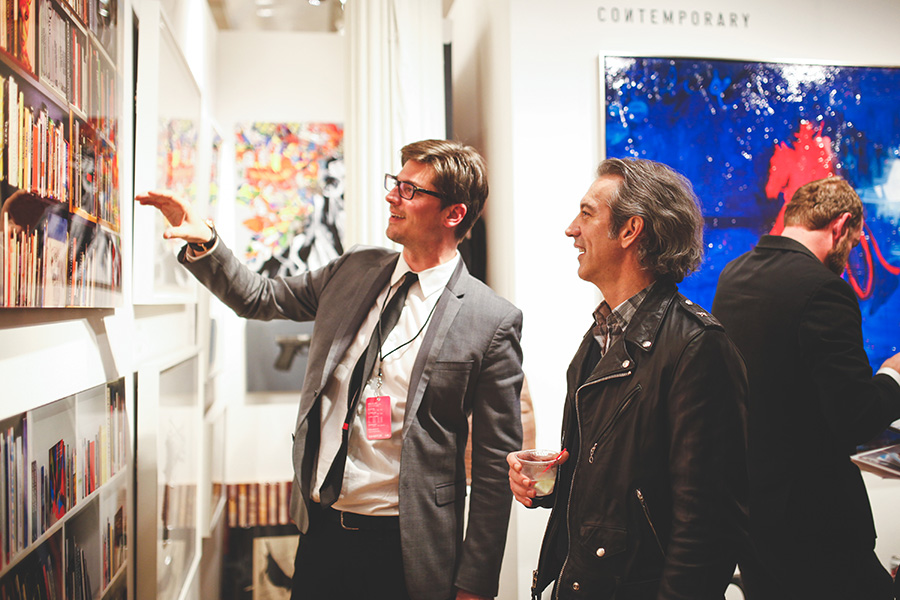 Art lovers talking about a piece at a private view