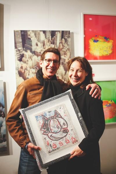 Couple taking art home